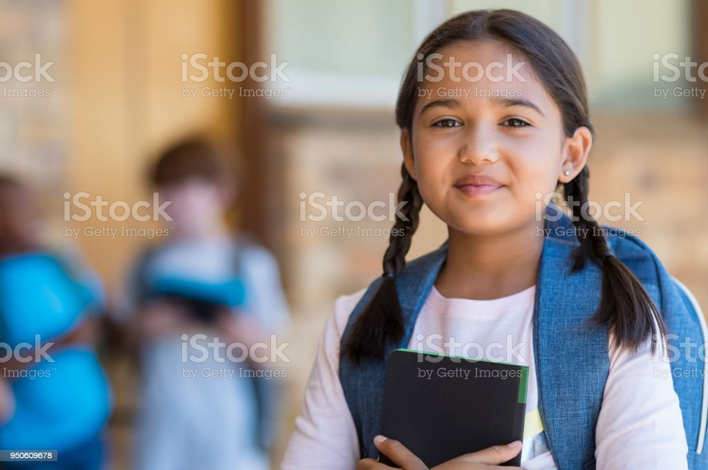 Elementary girl at school stock photo