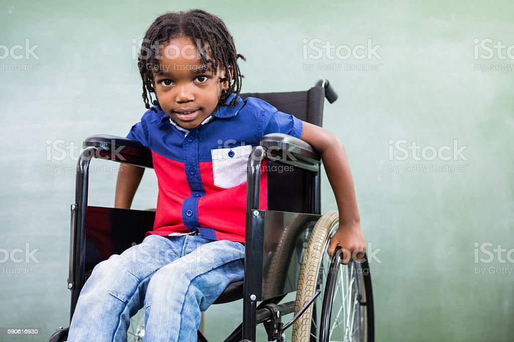 Elementary handicapped boy in classroom stock photo
