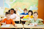 istock Elementary pupils sitting in a classroom 170049226