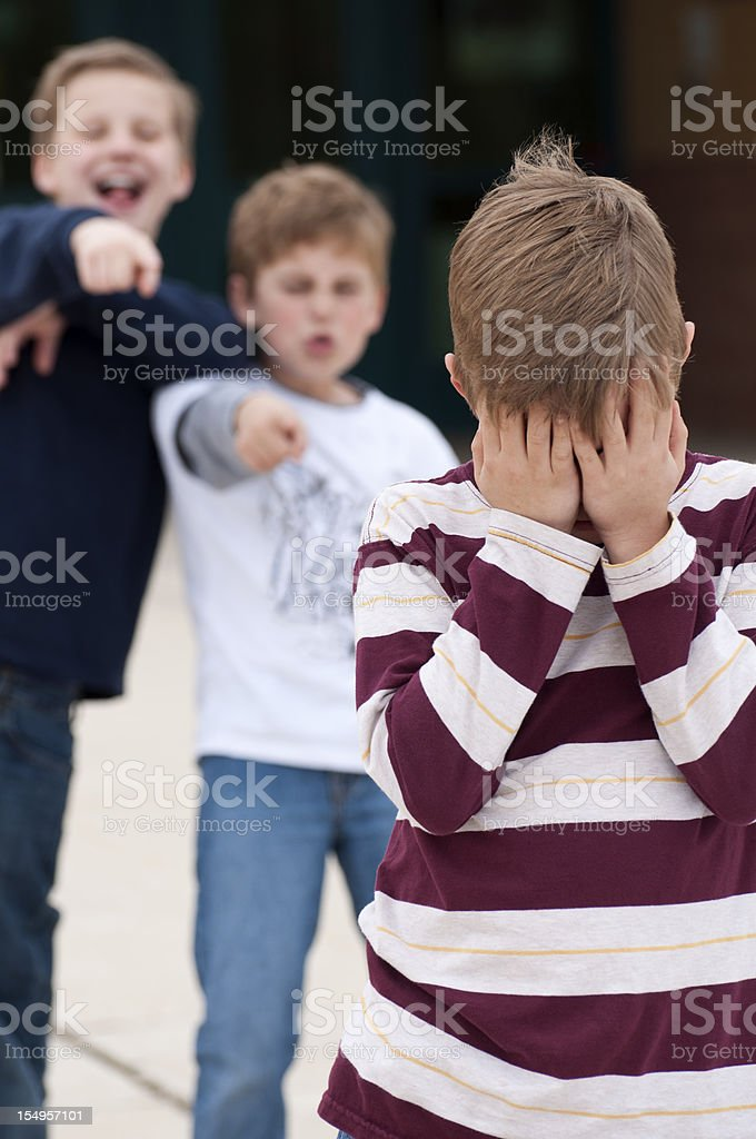 Elementary School Bullying Vertical royalty-free stock photo