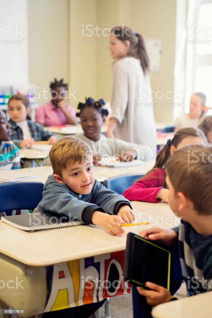 Elementary school children misbehaving in classroom. royalty-free stock photo