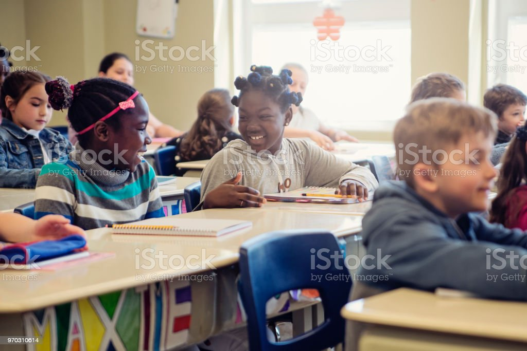 Elementary school children taking their places in classroom. royalty-free stock photo