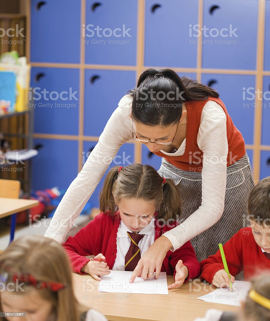 Elementary School Children Teacher Helping royalty-free stock photo