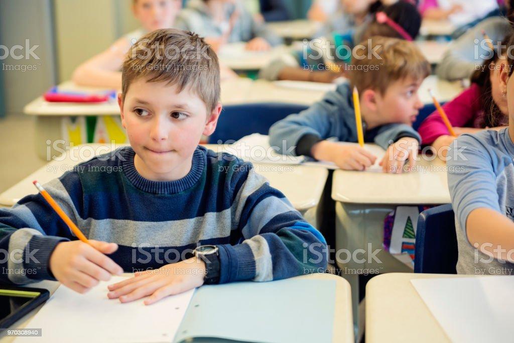 Elementary school children working in classroom. royalty-free stock photo