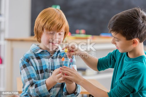 648947070 istock photo Elementary school friends build something in science class 648947036