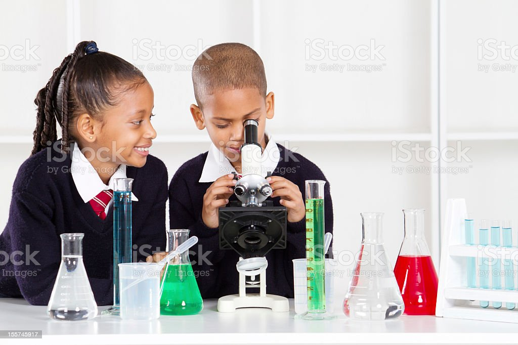 Elementary school kids experiment with Science equipment royalty-free stock photo