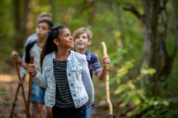 Elementary school kids hiking stock photo