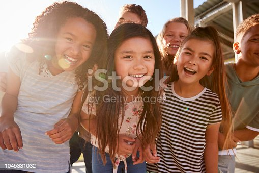 Elementary school kids smiling to camera at break time