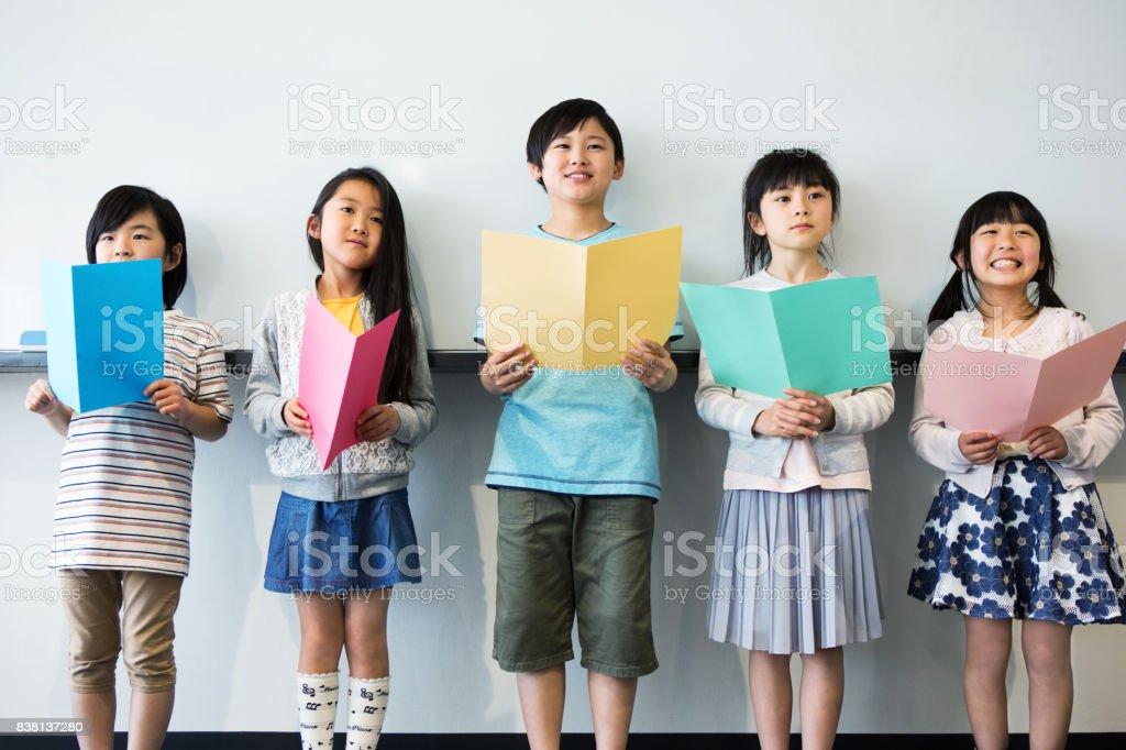 音楽の授業を受ける小学生 ストックフォト