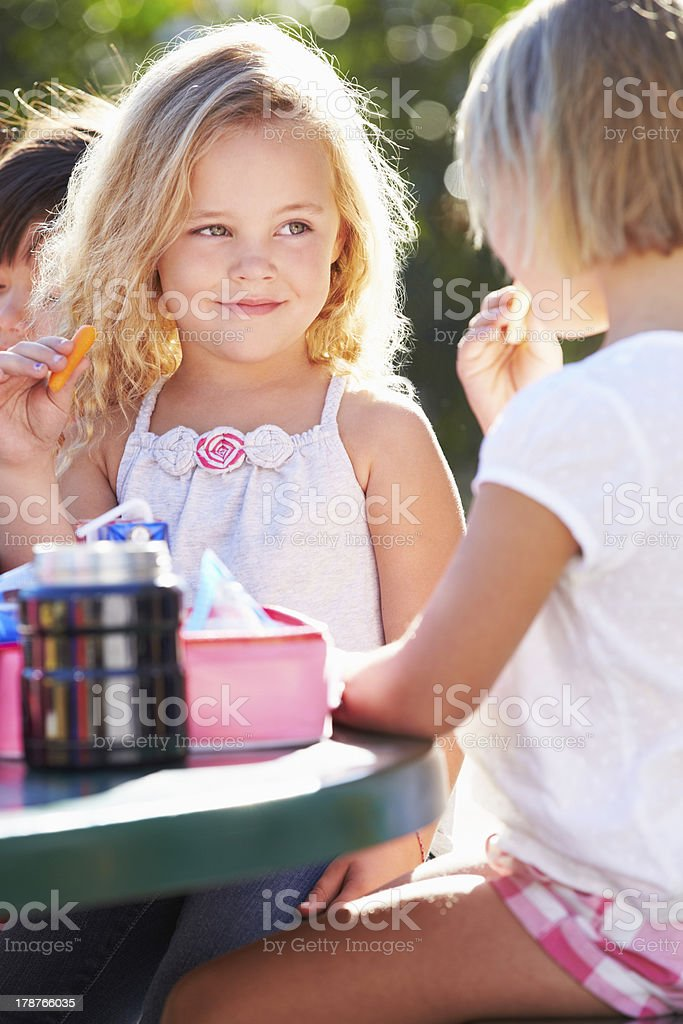 Elementary school pals eating lunch together royalty-free stock photo