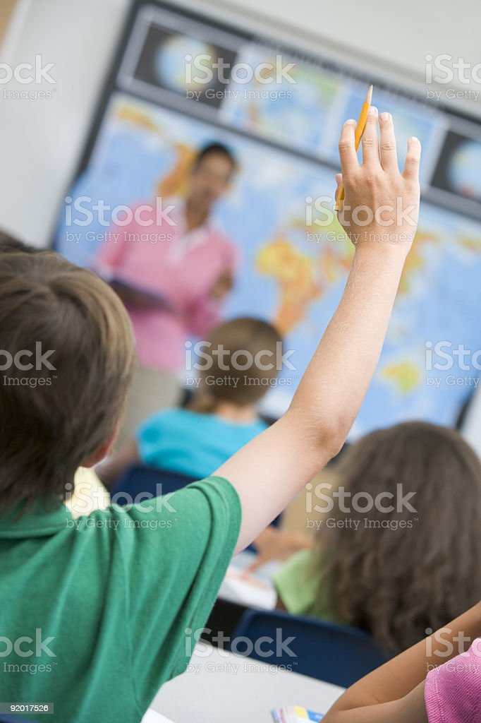 Elementary school pupil asking question royalty-free stock photo