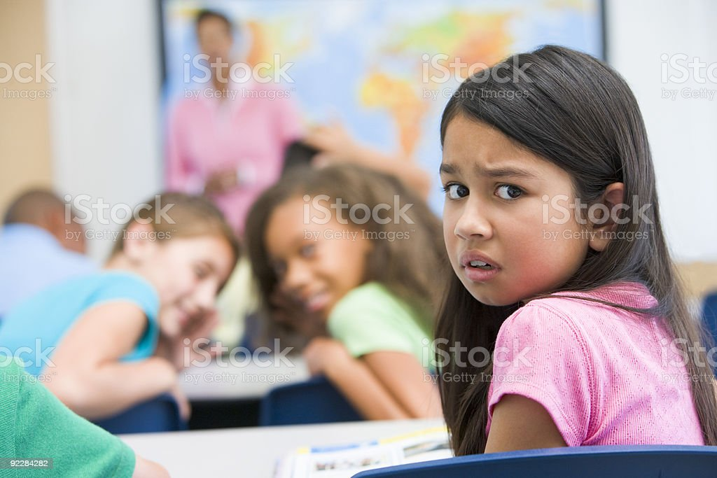 Elementary school pupil being bullied royalty-free stock photo