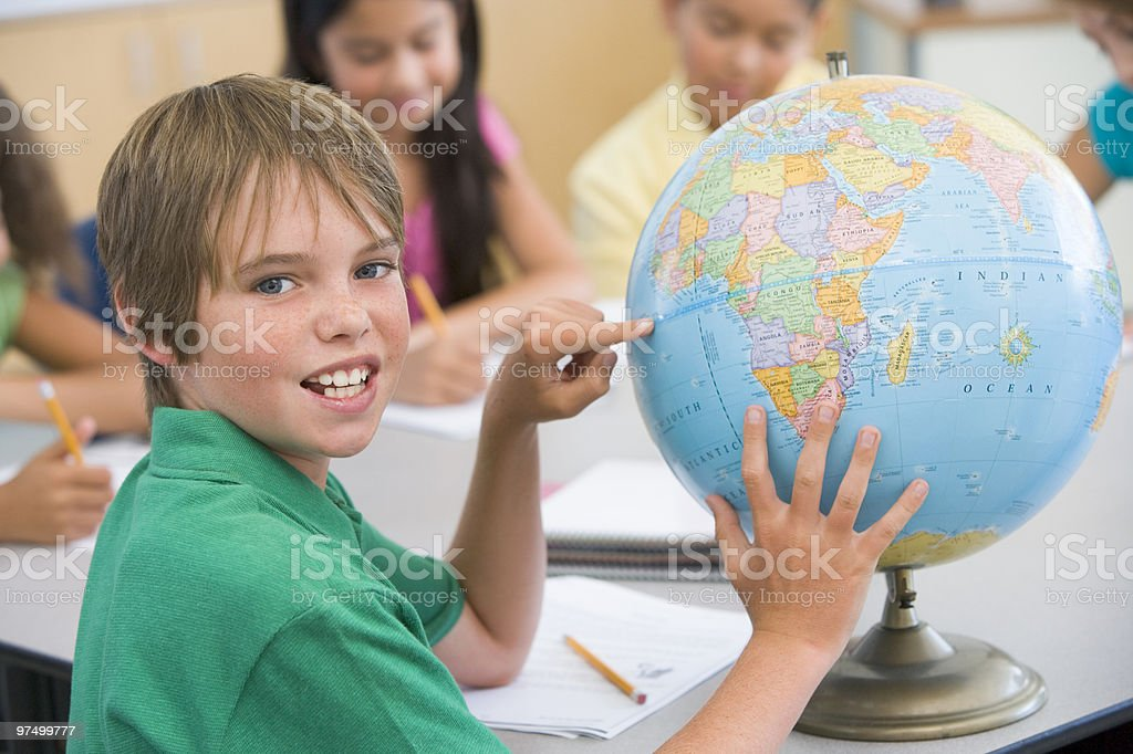 Elementary school pupil with globe royalty-free stock photo