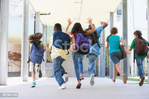 istock Elementary school pupils running outside 92284145
