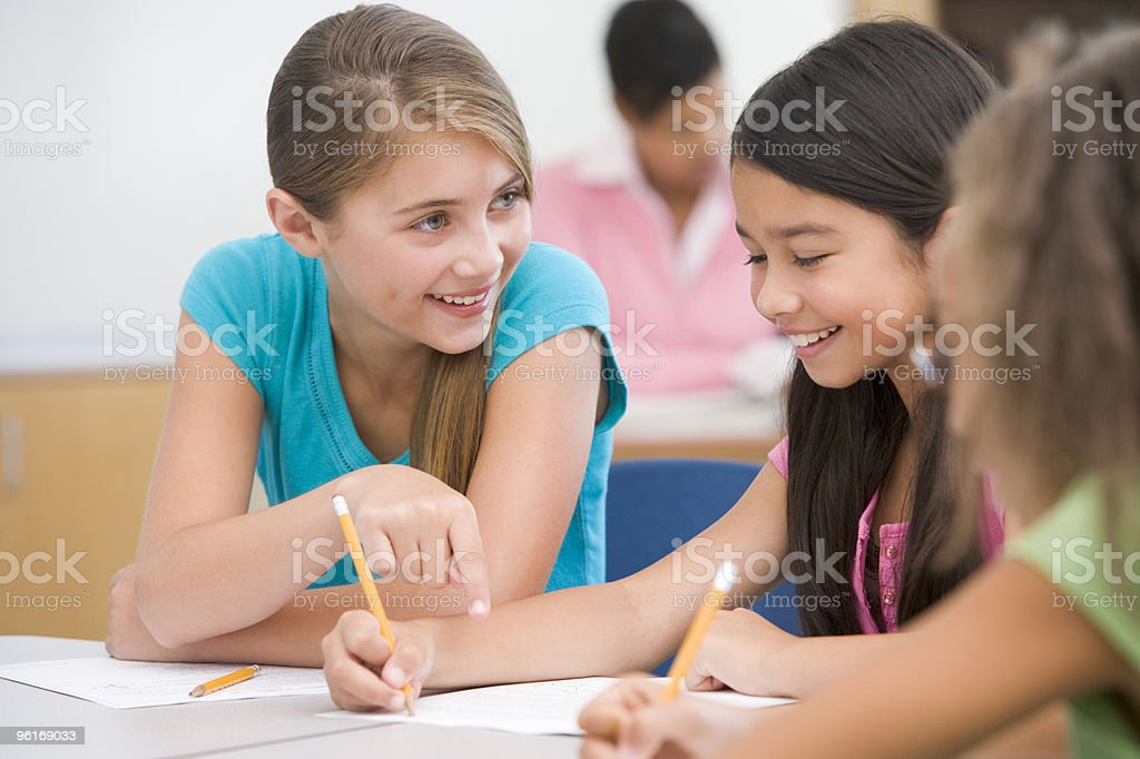 Elementary school pupils talking in classroom royalty-free stock photo