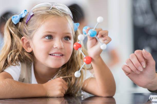 Elementary school student in science class stock photo