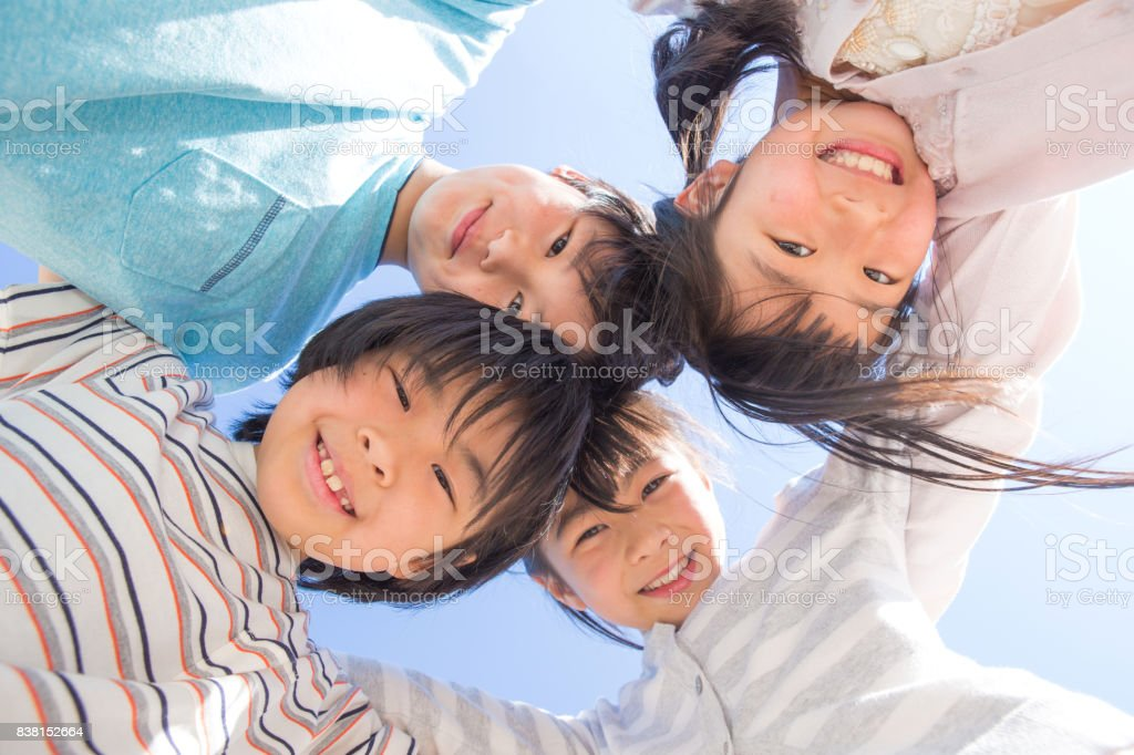 Elementary school students form a circle stock photo