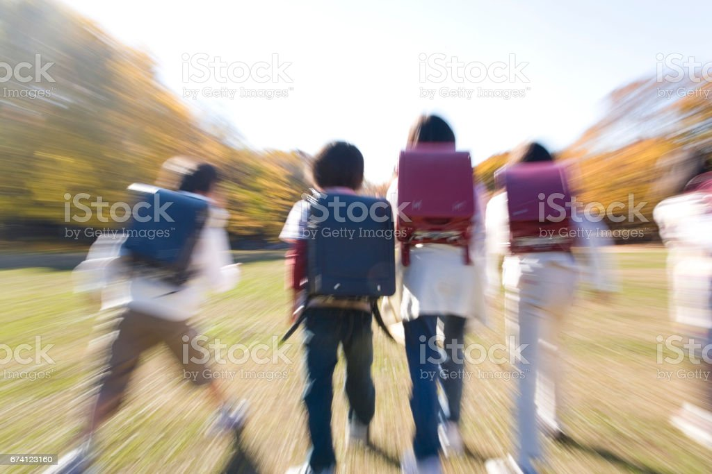 Elementary school students in run position royalty-free stock photo