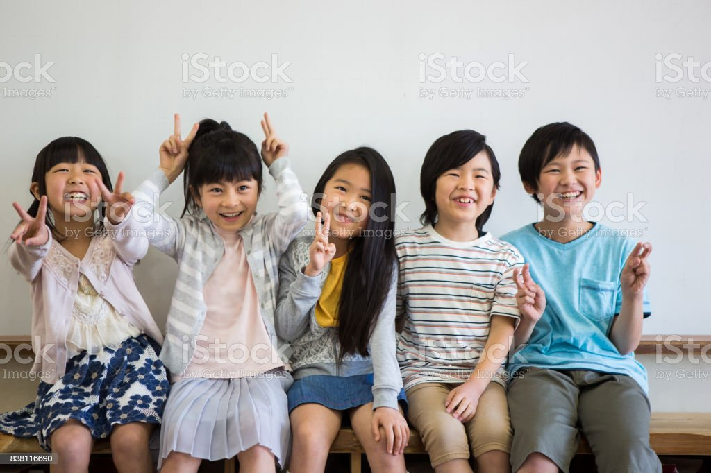 Elementary school students in the classroom stock photo