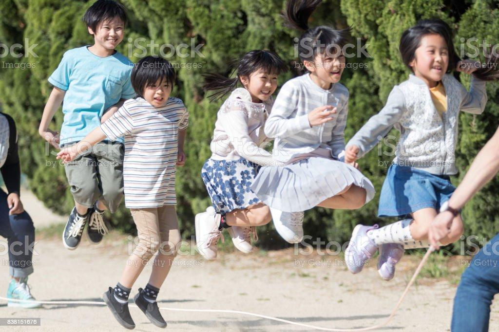 Elementary school students jump rope stock photo