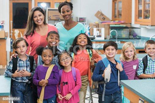 istock Elementary school students, teachers in science lab 638959554