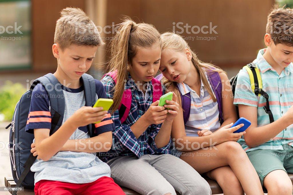 elementary school students with smartphones - Photo de Adolescent libre de droits