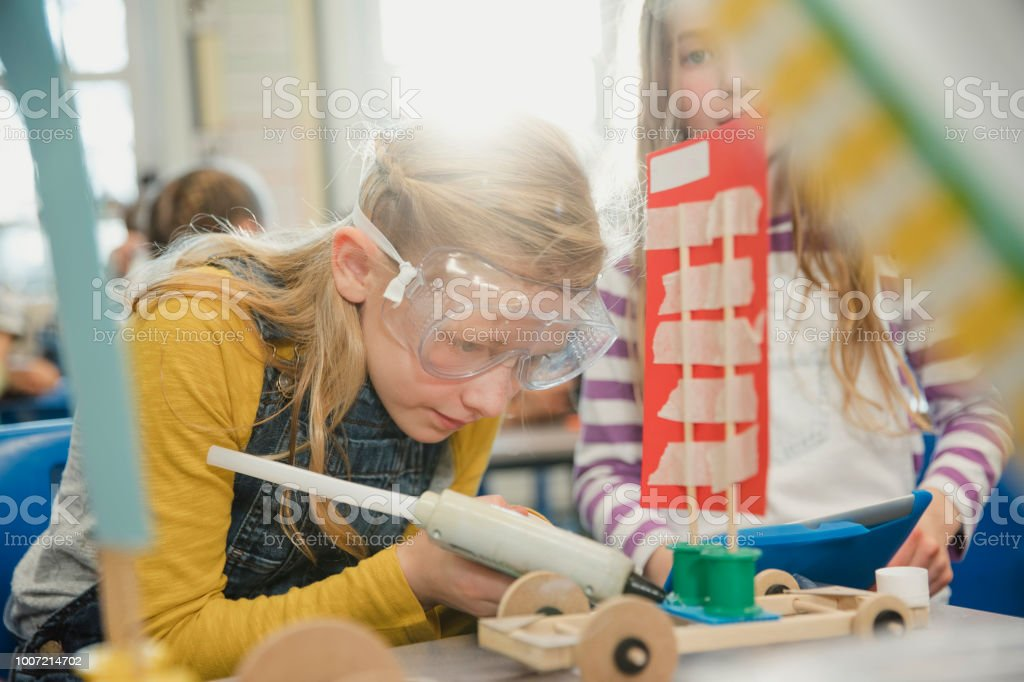 Elementary Schoolgirls Working Together on a Project stock photo