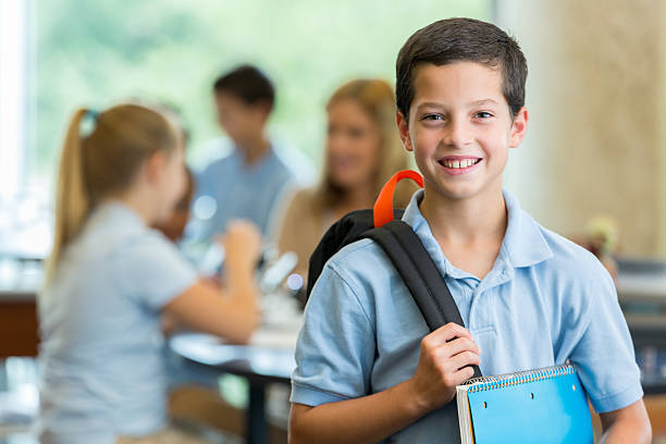 elementary student in classroom - private school stock photos and pictures