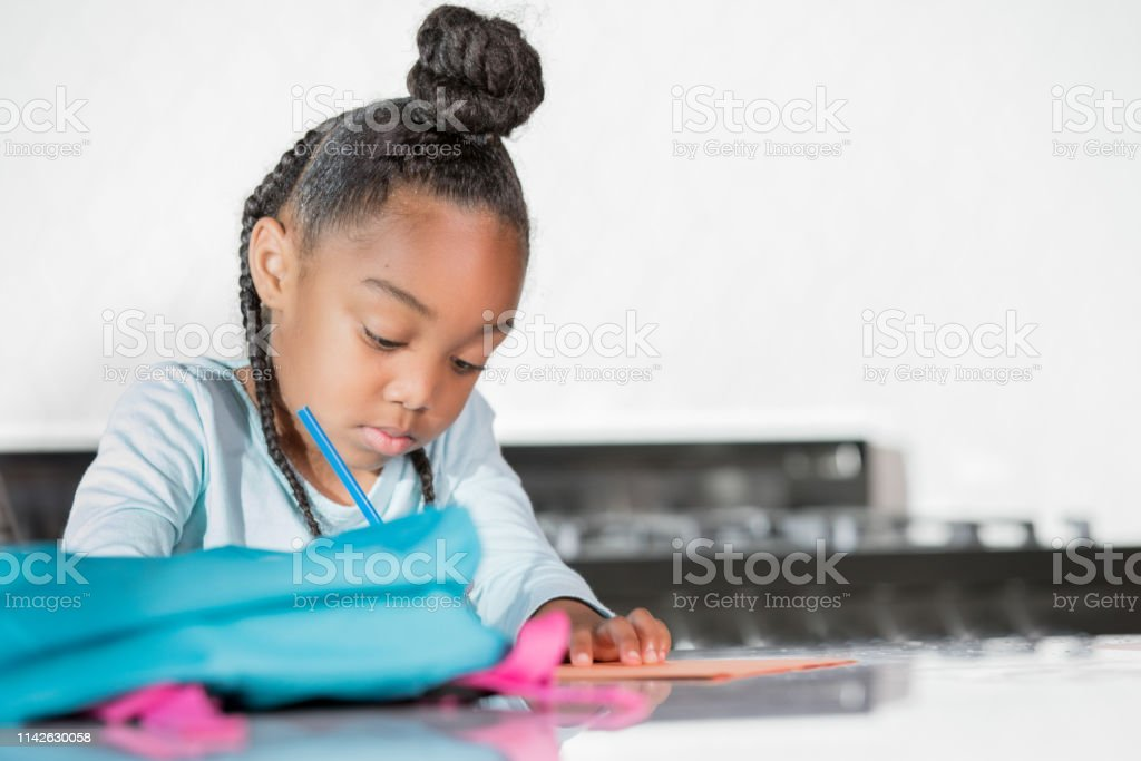 Elementary student working at her desk
