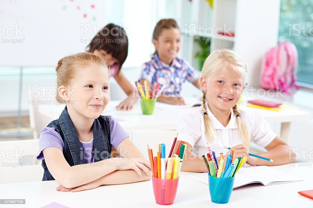 Elementary students at lesson royalty-free stock photo