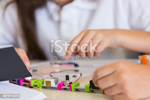 648947070 istock photo Elementary students learning about robotics in STEM class 497511076