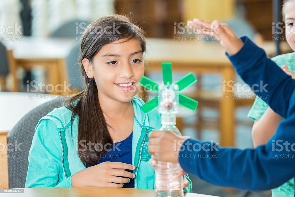 Elementary students learning about wind energy during science class stock photo