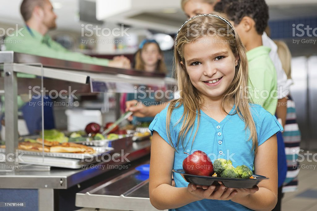 Elementary students making healthy choices in cafeteria line royalty-free stock photo