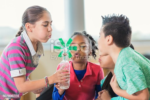 648947070 istock photo Elementary students studying alternative wind energy in science class 507996224