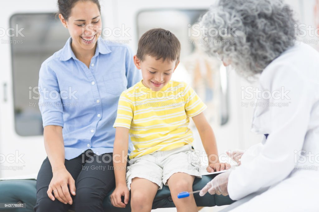 Elementaryage Boy Visits With His Doctor Stock Photo ...