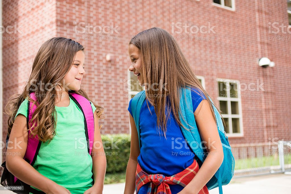 Elementary-age children on school campus going back to school. stock photo