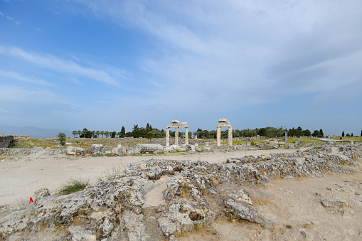 istock Elements of antique ruins of limestone blocks. The destroyed columns. Ruins of city of Hierapolis 1183401794