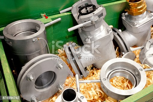 Elements of equipment for refueling in a wooden box with wooden shavings. Fueling the concept. Storage equipment design concept. Industrial concept. Engineering industrial background.