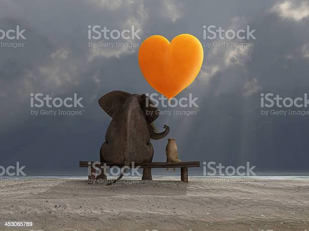 Elephant and dog holding a heart shaped balloon picture id453065789?b=1&k=6&m=453065789&s=612x612&h=rh5iynzvtddyngnmjliglcbqcjrih2ccjhqkzv13uum=