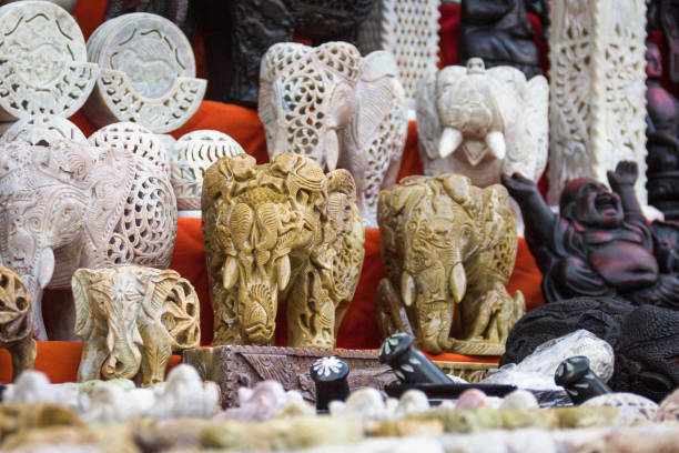 Elephant carved figures and Buddha statues Souvenirs on Wednesday market in Goa, India carving craft product stock pictures, royalty-free photos & images