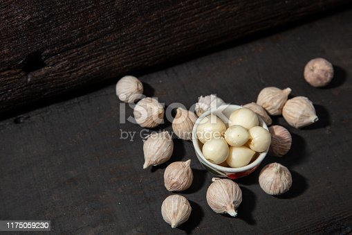 Elephant Garlic Single Bulb form healthy herb aroma food ingredient on black wood background