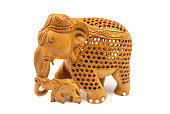 Traditional carved elephant mother and baby figurine souvenir, isolated on a white background