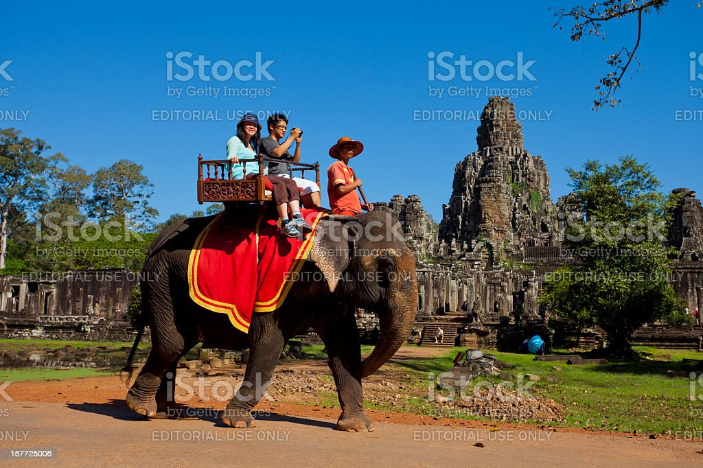 Elephant riding, Bayon in Angkor Thom, Cambodia stock photo