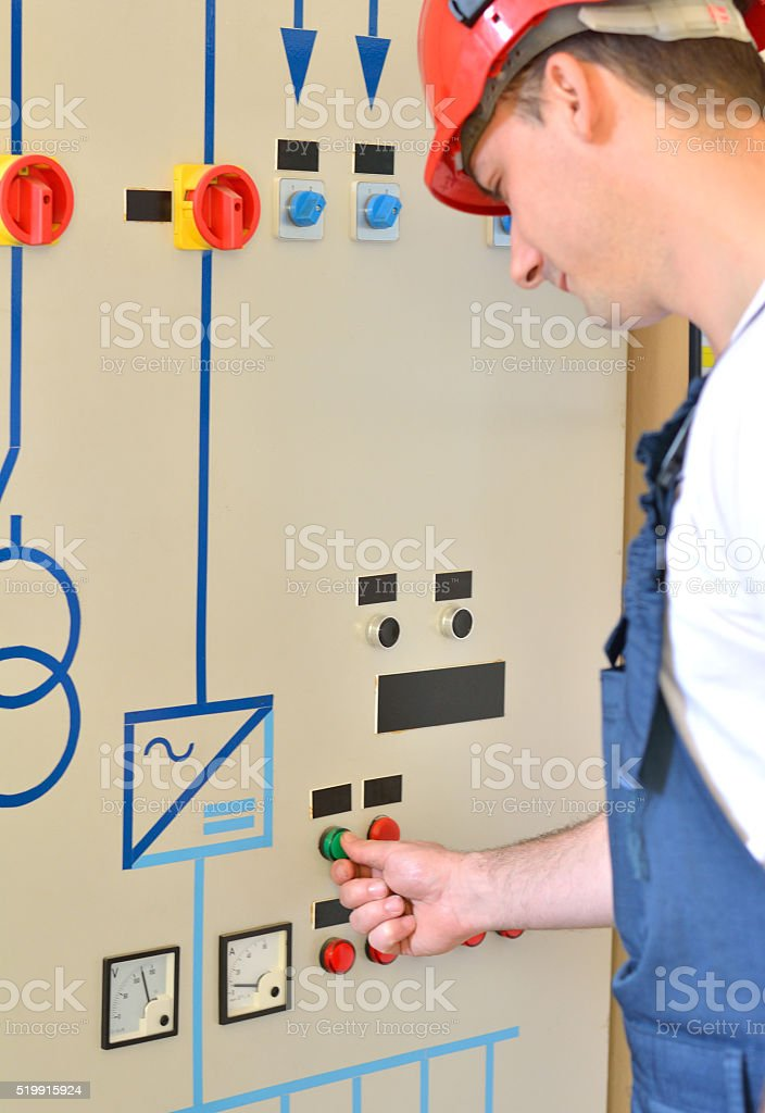 Eletrician Touching a Switch on the Panel stock photo