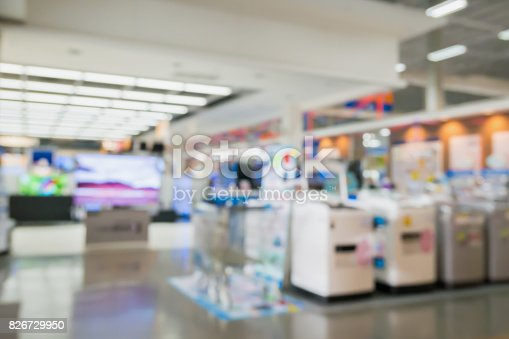 istock eletronic shop department store with bokeh blurred background 826729950