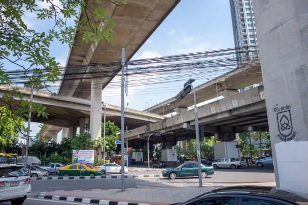 elevated causeways in bangkok, thailand - motorbike, umbrella stock photos and pictures