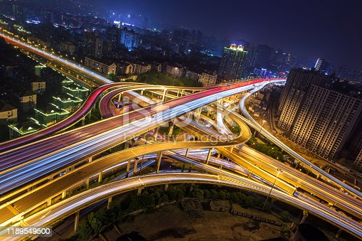 599471112 istock photo Elevated highway and overpass in modern city. 1189549500