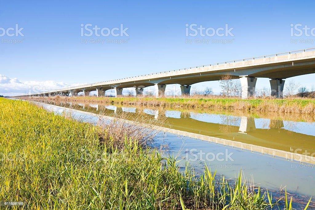 Elevated highway built built along a river stock photo