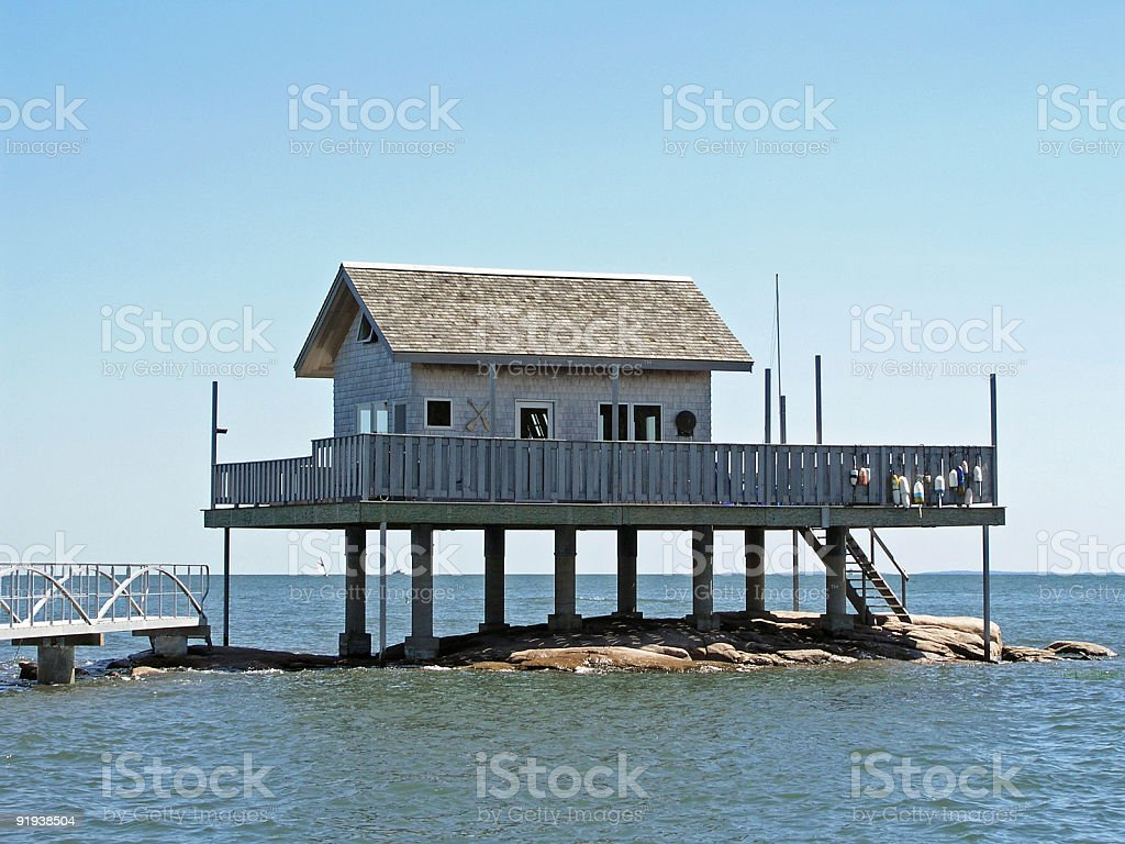 Elevated house on the water stock photo