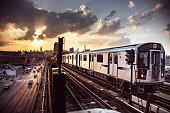 Elevated Subway Train and New York City Skyline